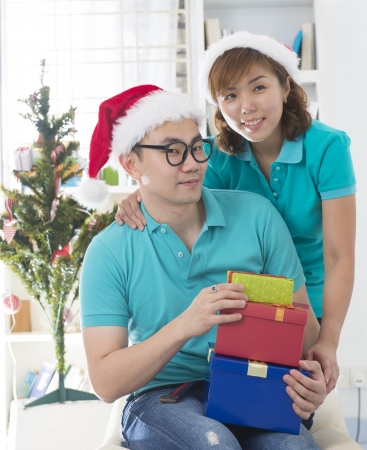 asian couple lifestyle christmas celebration gift sharing   photo