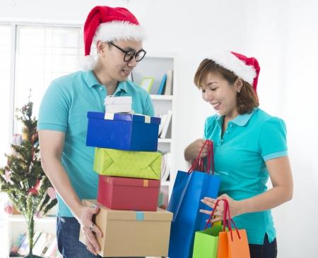 asian couple lifestyle christmas celebration gift sharing photo
