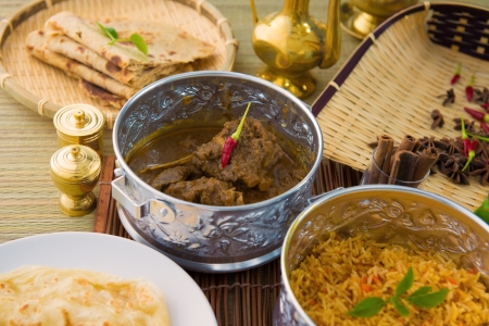 mutton korma famous food with traditional indian background items   photo