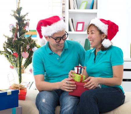 asian couple life christmas celebration gift sharing photo