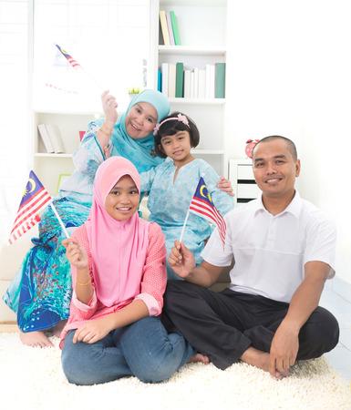 malay family with malaysian flag lifestyle photo Stock Photo
