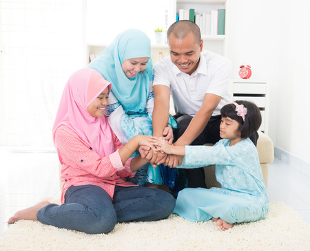 aidilfitri: malay family teamwork theme on home