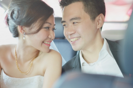 actual: Asian chinese bride and groom on their actual wedding day