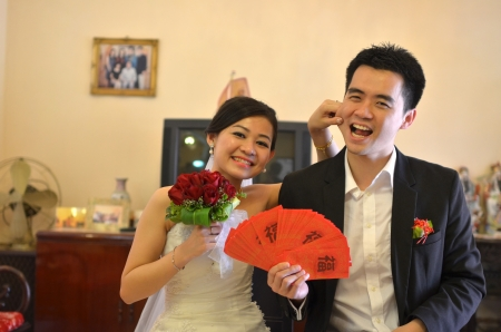 Asian chinese bride and groom on their actual wedding day   photo