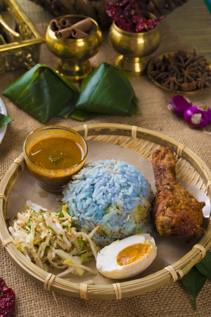 terengganu:  Nasi kerabu is a type of nasi ulam, popular Malay rice dish. Blue color of rice resulting from the petals of butterfly-pea flowers. Asian cuisine. Stock Photo