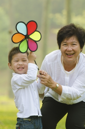 happy asian grandmother with grandson child playing outdoor photo