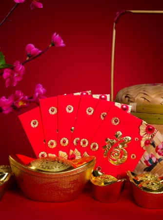 red packet: Chinese new year festival decorations, ang pow or red packet and gold ingots.