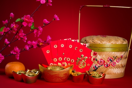 packets: Chinese new year festival decorations, ang pow or red packet and gold ingots.