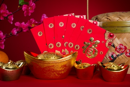 pow: Chinese new year festival decorations, ang pow or red packet and gold ingots.