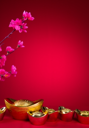 Chinese New Year Decoration plum blossom and gold bullion symbol of luck photo