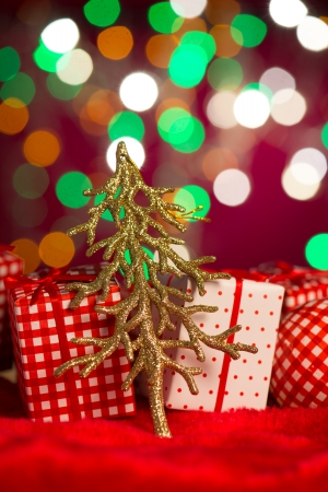 christmas decoration tree and presents on the background photo
