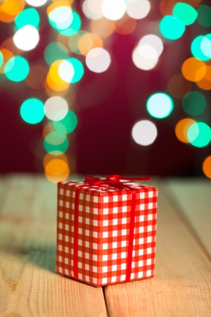 christmas decorations and presents with background lights photo