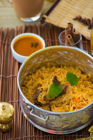 chicken biryani in small wok   photo