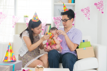 chinese family celebrating baby birthday party ,full moon   photo
