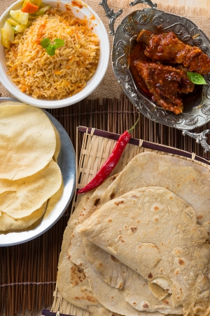 Chapati or Flat bread, Indian food, made from wheat flour dough. Roti canai and curry.   photo