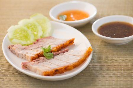 Siu Yuk - Chinese roasted pork served with soy and hoisin sauce.   Stock Photo