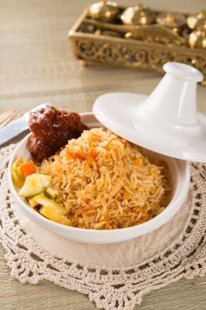 biryani: Biryani chicken rice cooked in arab style tajine with traditional india food