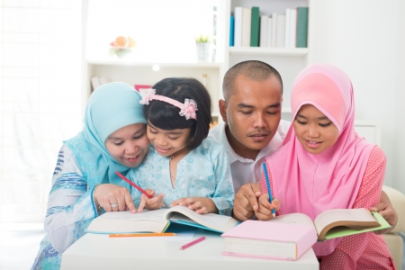 indonesian muslim family learning together with lifestyle Stock Photo - 24205679