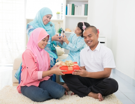 malay family gift exchange during holiday Stock Photo - 24205681