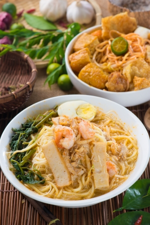 famous curry noodle or laksa mee with decorations.   photo