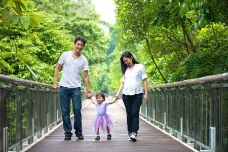 asia nature: chinese asian pregnant mother and family outdoor photo Stock Photo