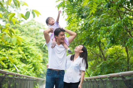 chinese asian pregnant mother and family