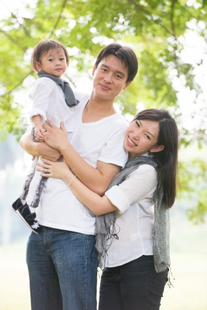 asian pregnant mother and family outdoor photo   photo