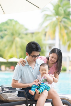 Happy Asian Family Playing in the pool photo
