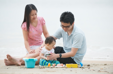 asian baby girl: Happy Asian Family Playing on the beach
