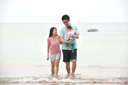 asian Family walking On the Beach photo