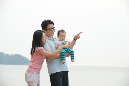 Portrait Of asian Family walking On the Beach photo