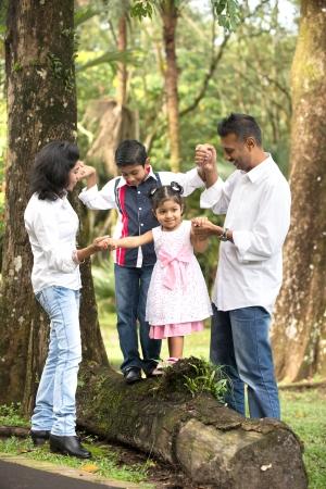 indian family teaching children to climb photo