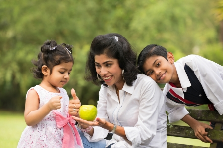 south india: indian family outdoor eating healthy photo