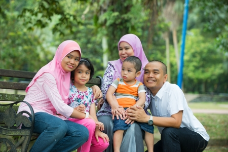 malay family having fun in the park ,malaysian people   photo
