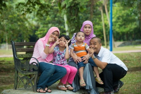 malay family having fun in the park ,malaysian people