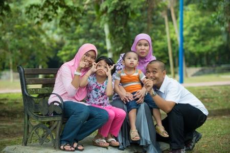 malay family having fun in the park ,malaysian people Stock Photo - 24944266