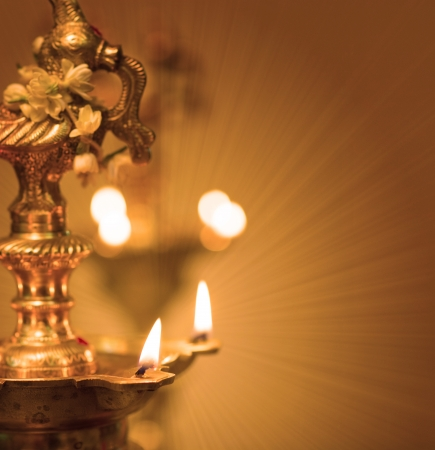 puja: diwali indian oil lamp with traditional background Stock Photo