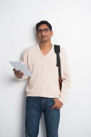 indian male: casual indian male student on a sweater and tablet Stock Photo