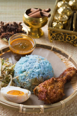resulting: Nasi kerabu or nasi ulam, popular Malay rice dish. Blue color of rice resulting from the petals of butterfly-pea flowers. Traditional Malaysian food, Asian cuisine.