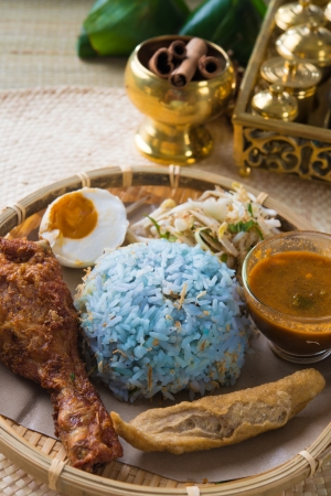 terengganu: Nasi kerabu or nasi ulam, popular Malay rice dish. Blue color of rice resulting from the petals of butterfly-pea flowers. Traditional Malaysian food, Asian cuisine.