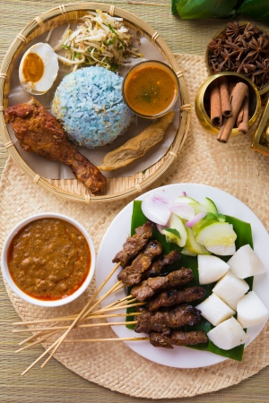 Nasi kerabu or nasi ulam, popular Malay rice dish. Blue color of rice resulting from the petals of butterfly-pea flowers. Traditional Malaysian food, Asian cuisine.   photo