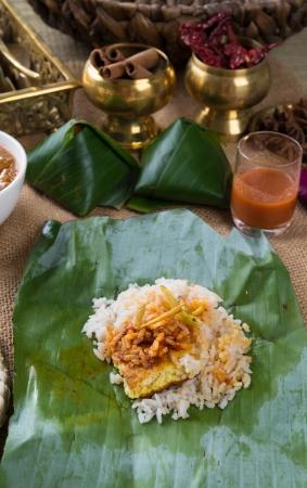 lemak: Malaysian traditional food coconut milk rice nasi lemak.   Stock Photo