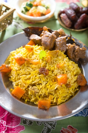 uzbek: Arab rice, rice with meat and carrot in a bowl. Middle eastern food.   Stock Photo