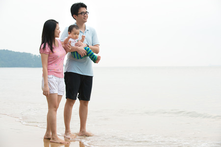 chinese asian Family walking On the Beach   photo