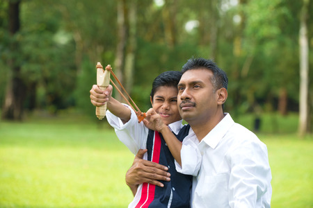 indian father and son fatherhood session with a sling shot