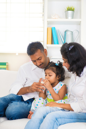 mother milk: indian family drinking milk daugther  Stock Photo