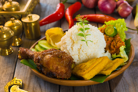 culinary: indonesian fried chicken rice on traditional