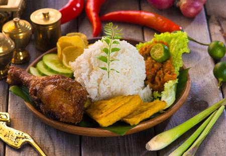 nasi ayam penyet, indonesian fried chicken rice Stock Photo