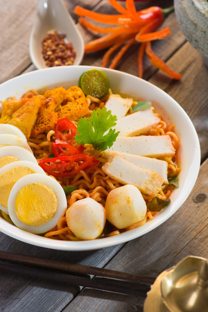 instant curry laksa noodle , singaporean style photo
