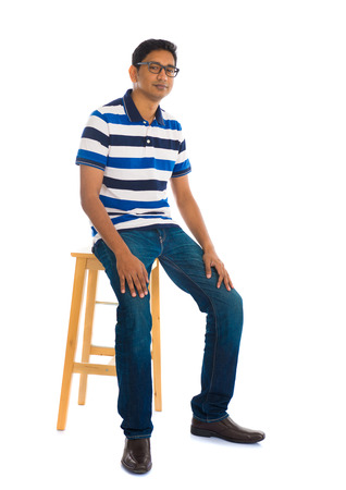 whole body: Full body indian man sitting on a chair over white background Stock Photo